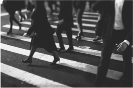 Business Leaders walking across an intersection for commerce