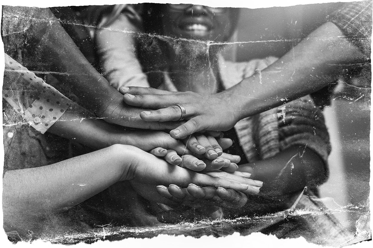 Diverse Group of Hands Working Together - Pile of Hands